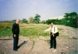 Local resident Mr. Sun and Historian Mr. Hsieh point to location of the former burial plot where those who died on the Enoura Maru were first buried in 1945.